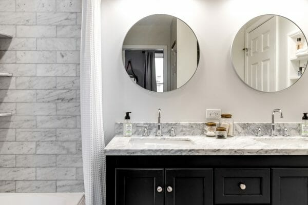 Two bathroom vanities above his and her sinks